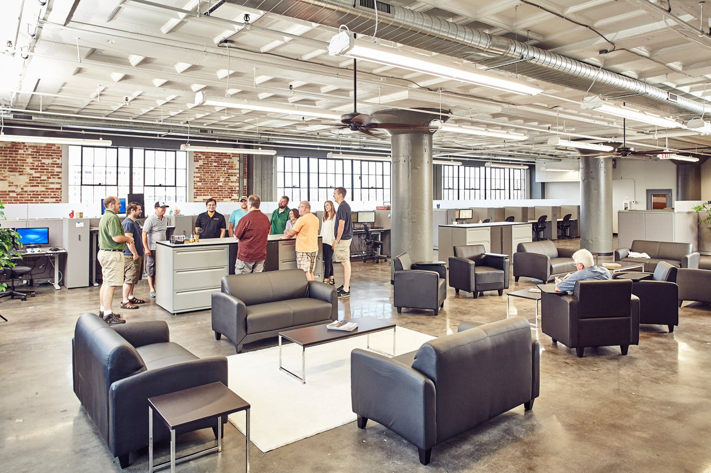 Large Office Space In In The Juxtaposing Sleek Modern Design And Large Industrial Windows Bringing An Open Contemporary Aesthetic To Stl Technology District Big Space Globe Building